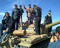 People on a tank in Benghazi